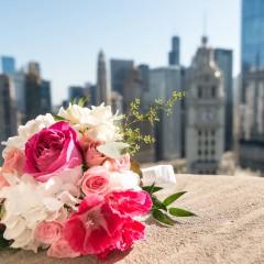 wedding bouquet against Chicago skyline